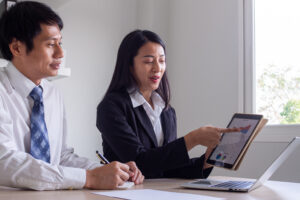 Credit Counselor Showing Client Their Credit Report